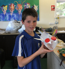 Grade 4 student Oliver with his artwork
